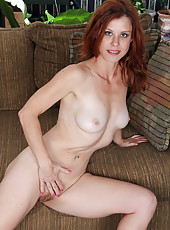 Redheaded Jessica Adams from AllOver30 slips a large dildo deep