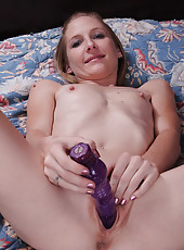 Thin and mature Beyla from AllOver30 plunges her purple toy deep