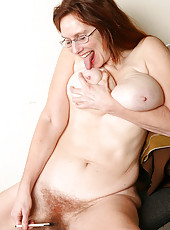 Redheaded MILF Breeze from AllOver30 massages her bushy beaver