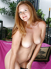 Slim mature redhead strips and enjoys her plastic friend in here