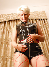 Fetish MILF in leather shows off her mature body for the camera