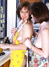 Two hot housewives eat more then just food inside the kitchen