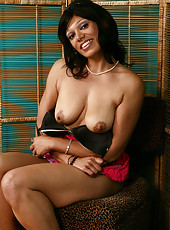 Exotic 32 year old Issabella spreads her legs to reveal her full bush