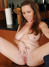 Horny housewife Tamara Fox from AllOver30 gets hot in the kitchen