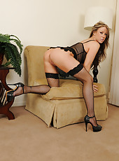 Gorgeous older MILF Carolyn Reese in black fishnet stocking