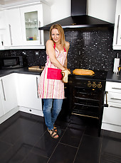 33 year old housewife Tara Trinity slips off her denim jeans in the kitchen