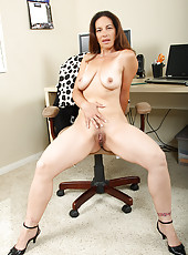 Long haired brunette MILF displaying some hot mature ass
