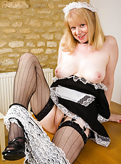 52 year old maid in fishnet stockings spreads he hot legs
