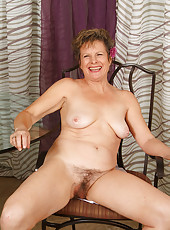 Horny 55 year old Judy plays with her mature and hairy pussy