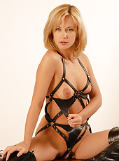 Tight bodied Laurita in soft bondage gear shows of her shaven pussy