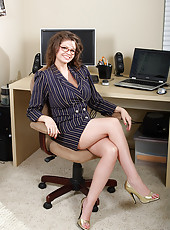 Busty office administrator becomes bored so strips for the camera
