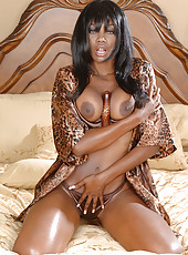Gorgeous ebony MILF stuffs her pussy with a fancy plastic vibrator