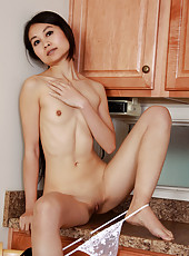 Exotic 30 year old Amber Thi from AllOver30 strips in the kitchen