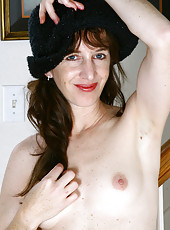 Petite 34 year old Jane shows of her mature and hairy pussy