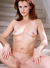 Redheaded MILF Kate B preads more then just Christmas cheer