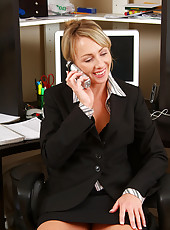 Mature secretary gets herself off while on the phone with a client