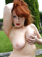Busty and redheaded MILF gets down and dirty in the backyard