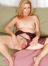 Sexy MILF Marie Kelly looks great in this purple lingerie