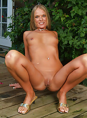 Katie flaunting her tight mature body in the backyard