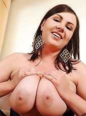 Busty Marille playing with a dildo
