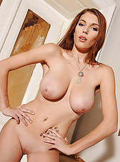 Slender busty Domenica gets naked