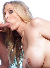 Busty hot blonde MILF Julia Ann tricks younger guy into fucking her pussy and making her orgasm.