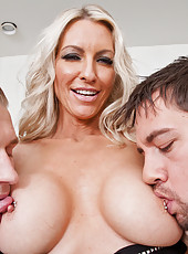 Horny MILF Emma Starr gets fucked and sucked by two guys in her first DP scene.
