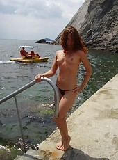 Nudist redhead MILF posing outdoors