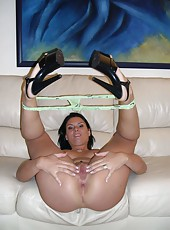 Sexy brunette MILF naked in the living room