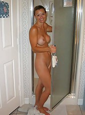 Alluring naked mom taking clothes off