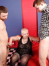 Two hung dudes teaming up to please an insatiable fat oldie