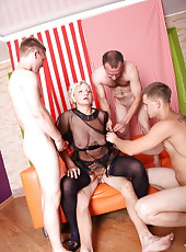 Boys getting some pussy and ass from an eager old hooker