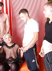 Hot mom with big tits takes it in every hole during gangbang