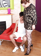 Big fat granny in patterned nylons gets her pussy worked out