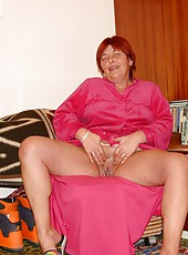 Chubby old woman in pink gown demonstrates pussy