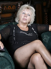 Old hot woman in fishnet stockings rubs her pussy