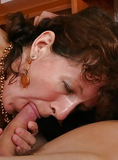 Shapely old woman sucks and rides a young dick