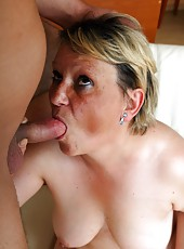 Old woman willingly swallows a big young cock