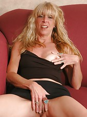 Naughty granny takes off her little black dress