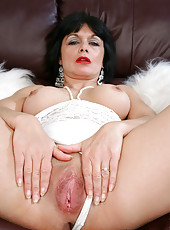 Steamy milf Barbie Stroker spreads her wet pussy