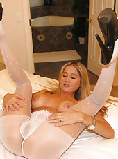 Rio stretching out her pantyhose and rubbing her wet pussy
