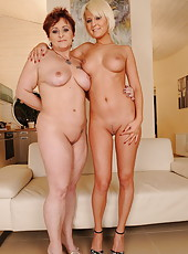 An older and a younger woman having lesbian sex