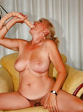 Old busty whore toyin with dildo and sucking dick