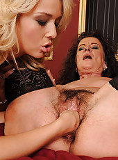 Hairy mom in black stockings fisted by sexy blonde