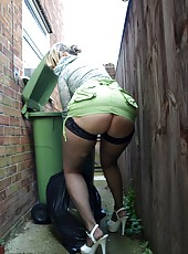 Dirty housewife Daniella takes out the trash in her fishnet stockings