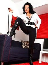 Danica in opaque leggings and black leather boots