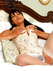 Danica in corset and white stockings playing with her dildo