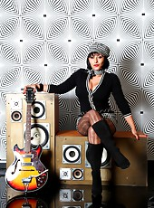 Retro Danica in 60s style mini skirt, pantyhose and boots