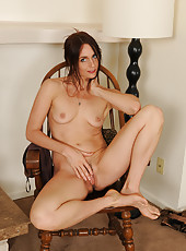 Elegant 38 year old Jasnime from AllOver30 spreading her meaty pussy