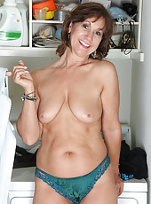 Horny 53 year old housewife Lynn having naked fun with the laundry